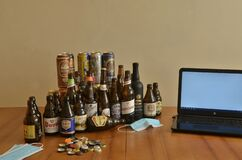 Assortment of artisan beer bottles and cans on table. Drinking at home in pandemic times. Work from home.