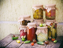 Assortment autumn preserves. Jars of pickled vegetables and jam. Selective focus Stock Photos
