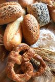 Assortment of baked bread. With seeds or simple and pretzels Stock Photography
