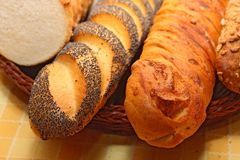 Assortment of baked bread. Long loafs and loaves of various kinds of bread stock images