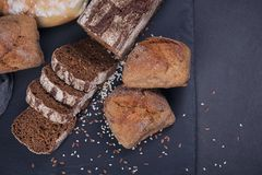 Assortment of baked bread on dark background. stock images