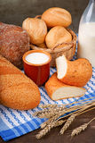 Assortment of baked bread with milk cup and bottle Royalty Free Stock Image