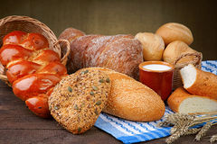 Assortment of baked bread with milk cup Stock Images
