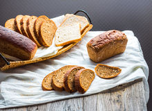 Assortment of baked bread, slices of rye bread, bran cereal, rus Stock Photo