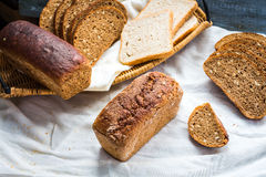 Assortment of baked bread, slices of rye bread, bran cereal, rus Royalty Free Stock Image