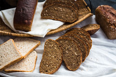 Assortment of baked bread, slices of rye bread, bran cereal, rus Royalty Free Stock Images