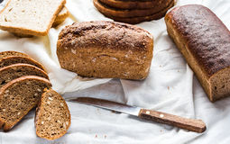 Assortment of baked bread, slices of rye bread, bran cereal, rus Stock Images
