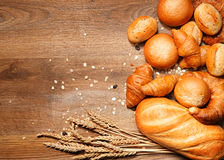 Assortment of baked bread on wood Royalty Free Stock Photos