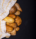 Assortment of baked goods on black table Royalty Free Stock Image
