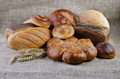 Assortment of baked goods lying on sacking Royalty Free Stock Photography