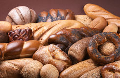 Assortment of bakery. Dark background with assortment of fresh bakery Stock Images