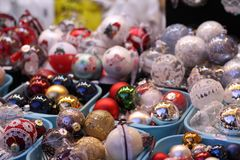 Assortment of balls toys for the Christmas tree in baskets in store stock image