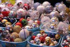 Assortment of balls toys for the Christmas tree in baskets in store stock photos