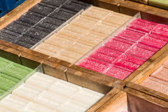 Assortment of bars of soap at the market. Assortment of bars of soap for sale on the market Stock Image