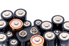 Assortment of batteries. Closeup of an assortment of batteries in different sizes, shapes and voltage on a white background Stock Photography