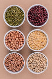 Assortment of beans and lentils in wooden spoon isolate on white Royalty Free Stock Image