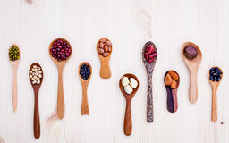 Assortment of beans and lentils in wooden spoon set up on wooden Royalty Free Stock Images