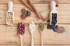 Assortment Of Beans And Lentils In Wooden Spoon On Wood Backgrou Stock Image