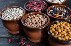 Assortment of beans on wooden background. Soybean, red kidney be Royalty Free Stock Photos