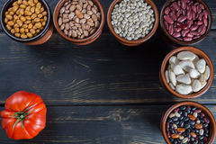 Assortment of beans on wooden background. Soybean, red kidney be Royalty Free Stock Photography