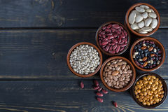 Assortment of beans on wooden background. Soybean, red kidney be Stock Image