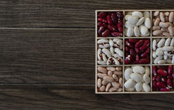 Assortment of beans in wooden box. Royalty Free Stock Photography