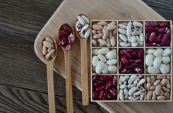 Assortment of beans in wooden box. Stock Photography