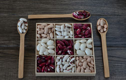 Assortment of beans in wooden box. Stock Photos