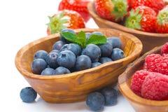 Assortment of berries - raspberries, blueberries and strawberry. Assortment of berries - raspberries, blueberries and strawberries in bowls, isolated on white Royalty Free Stock Photo