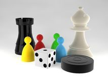 An assortment of boardgame pieces. Chess, draught, dice Royalty Free Stock Images