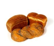 Assortment of bread. One loaf with sesame is on the left Stock Image
