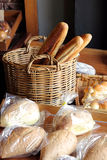 Assortment of Bread at Bakery. Assortment of freshly baked bread, buns and baguette at bakery shop royalty free stock photography