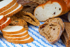 Assortment of bread on a blue tablecloth Royalty Free Stock Images