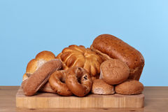 Assortment of bread on a bread board Royalty Free Stock Images