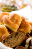 Assortment of bread and rolls served in a basket Stock Images