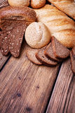 Assortment of bread on a wooden table Royalty Free Stock Photography