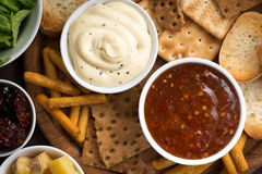 Assortment breads and appetizers with sauces, top view Royalty Free Stock Photography