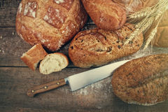 Assortment of breads on wood Stock Photo