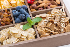 Assortment of breakfast cereal, dried fruit, berries and nuts Stock Photo