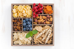 Assortment of breakfast cereal, dried fruit, berries and nuts Stock Photography