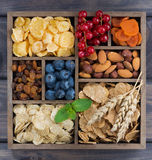 Assortment of breakfast cereal, fruits, berries and nuts Royalty Free Stock Photos
