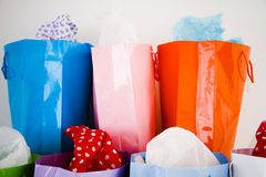 Assortment of bright coloured shopping bags. With gift wrap Royalty Free Stock Photo