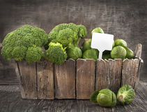 Assortment cabbages on wooden background Royalty Free Stock Photos