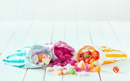 Assortment of candies in three bags over a table Royalty Free Stock Photography