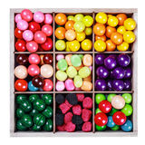 Assortment of candy and gum in a wooden box Royalty Free Stock Photos