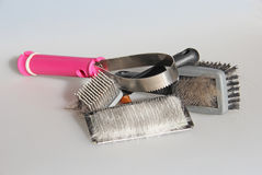 Assortment of Cat Brushes with Cat Hair Royalty Free Stock Photos