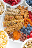 Assortment of cereal muesli bars, fresh and dried fruit on plate Stock Images