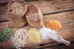 Assortment of cereals on a wooden table Stock Photos