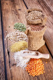 Assortment of cereals on a wooden table Royalty Free Stock Image