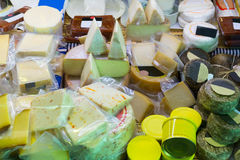 Assortment of cheese at market stand Stock Image